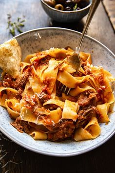 16 Filling Pasta Recipes to Refuel With This rustic Italian beef ragu requires minimum skill or effort as it is made easily in a slow cooker. Use it with spaghetti or in lasagna and freeze the rest! Top Recipes, Crockpot Recipes, Dinner Recipes, Healthy Recipes, Pasta Recipes, Italian Dishes, Italian Recipes, Italian Foods, Italian Cooking