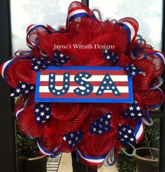 "made with mini flags and red ""bath poufs""? 4th of July or Memorial Day Wreath  Red, White, & Blue ""USA"""