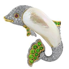 Gem Set Pearl Gold Dolphin Pin | From a unique collection of vintage brooches at Gem Set Pearl Gold Dolphin Pin Offered By Shreve, Crump & Low $15,500 https://www.1stdibs.com/jewelry/brooches/brooches/