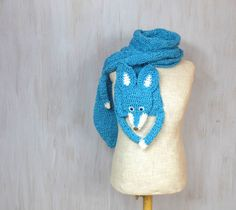 """Blue fox, handmade soft scarf  Soft and nice blue turquoise fox — made by me, made of soft blue turquoise and white yarn, with plastic blue eyes on small pieces of polyfelt and plastic nose.  Length with paws and tail: 83 (211 cm), without paws and tail (only """"body""""): 60 (154 cm) Width: 9 (22 cm)   Made in a smoke free house.  Ready to ship.   Please check dimensions carefully. Due to lighting conditions and monitor settings, colors may appear slightly different, than they are. Items are…"""