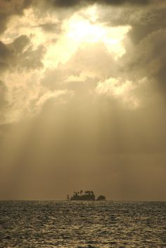 Sunset in the San Blas Islands in Panama -- almost like God's flashlight shining down on this tiny island.