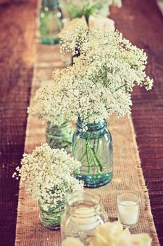 different sizes of baby's breath centerpieces.  fits my theme: rustic and ethereal.