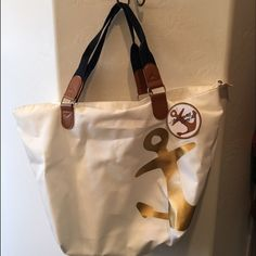 "Gorgeous White Tote Large NWT white tote with gold anchor & nylon handles. 24""L x 9"" W x 14""H strap drop 9"". No trades Bags Totes"