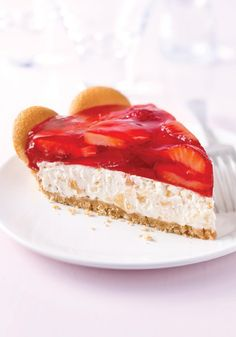 Tropical Strawberry Cream Pie -- Studded with pineapples and topped with fresh strawberries, this dessert recipe is a welcome sight no matter the latitude.