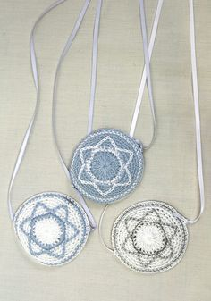 These kippot are designs for a Brit Milah or a baby boy at Temple services. Hand crocheted. Strings tie to keep the kippah in place. Please specify which one you want in the comments box at the end of the ordering process. Lt. Blue w/ white star, White with Lt.blue star or White with silver star.