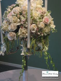 Cascading flowers with pearls on wire and baby's breath for centerpieces in wedding colors. Candelabra Flowers, Candelabra Centerpiece, Silver Candelabra, Wedding Table Centerpieces, Flower Centerpieces, Wedding Candelabra, Centerpiece Ideas, Floral Decorations, Centrepieces