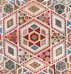 Late -19th-century charm quilt Geometry gives us many ways to set hexagons together. Some of the most amazing are medallions that r...