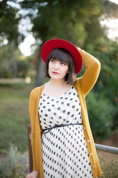 one of my favorite blogs. love this polka dot dress and mustard cardigan