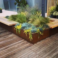 Roof garden - Corten planter with bench., Roof garden - Corten planter with bench. - Roof garden - Corten planter with bench.