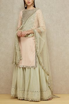 Abhinav Mishra brings fresh and bright pastels featuring a light pink kurta with embellished yoke paired with a mint sharara and dupatta set. Style the look with diamante danglers and juttis. Sharara Designs, Lehenga Designs, Sari Blouse Designs, Kurti Designs Party Wear, Pakistani Bridal Dresses, Indian Dresses, Indian Outfits, Bridal Lehenga, Mirror Work