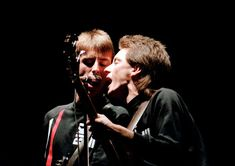 """These previously unseen photos of The Jam are from 'Absolute Luck' (www.absoluteluck.co.uk), at Soho's Tapestry Gallery(www.tapestry.co.uk). Photographer Derek D'Souza: """"One of the few times I managed to capture Paul and Bruce singing into the same microphone. Very Lennon and McCartney."""" – Wembley Arena 02.12.1982  """"A great location at Chiswick Park – the angle […] Chiswick Park, Wembley Arena, Lennon And Mccartney, Paul Weller, Piece Of Music, Back In The Day, Photo Sessions, New Books, Concert"""