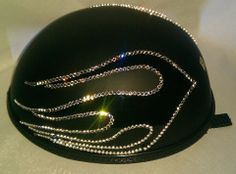 Bling your Motorcycle Helmet to match your ride. We use Genuine Swarovski Crystals for the best sparkle and shine. Create your own design for your helmet or let us do it for you. Sparkle up your day with Custom Bling by Ricci~  Gloss Flames over a mat black novelty helmet. Trimmed out in Genuine Swarovski Crystal.