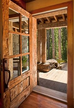 I am so in love with this front door! Reclaimed wood custom built door to the log home in Big Sky, Montana. Look at the ax marks on the wood! Gorgeous, rustic, and obviously a heavy door! Cabin Homes, Log Homes, Style At Home, Rustic Doors, Wooden Doors, Rustic Entry, Rustic Exterior, Timber Door, Design Case