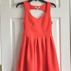 Perfect Spring dress Charming peachy colored dress. Nice for spring weddings or other upcoming occasions.Dainty and feminine in the front with a little drama in the back. Dresses