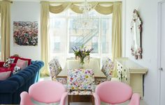 "Want to make a variety of bright colors cohesive? Think about how you would arrange a flower bouquet, as Sasha Bikoff did in this SoHo apartment. ""The same can apply to a space, but you need to find a connection,"" she says. ""Here, that connection is the fabric on the dining room chairs, which showcases colors also found throughout the room."""
