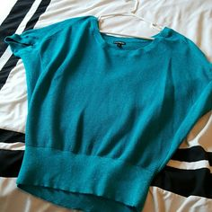 Teal short sleeve top that sparkles Worn once, good condition express Tops Blouses