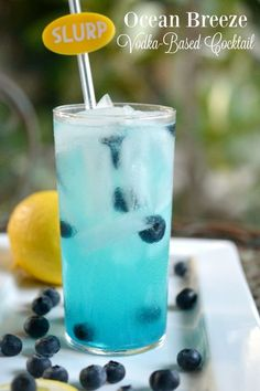 Ocean Breeze: A Simple Vodka Cocktail - http://www.sofabfood.com/ocean-breeze-vodka-cocktail/ Transport yourself to the beach this summer when you make thisOcean Breeze Vodka Cocktail recipe. Vodka, fresh lemon juice, and Blue Curacao are mixed together in a high ball glass served over ice and garnished with blueberries.  Ocean Breeze: A Simple Vodka Cocktail One sip of thisOcean B...