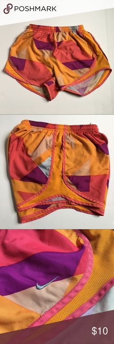Size Small Nike Dri-Fit Running Shorts Gently worn multi colored Nike Dri-Fit running shorts. Fits true to size and still has inner lining in place. Nike Shorts
