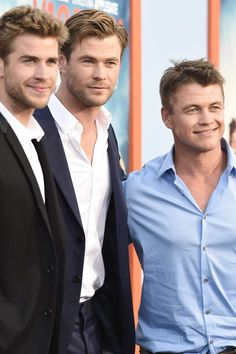 When he posed with his brothers and it was almost too much Hemsworth to handle.