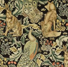 Forest Velvet A tapestry inspired fabric depicting a forest scene with peacocks, hares and foxes set amongst scrolling acanthus leaves. Digitally printed on black with gold, duck egg blue and natural shades of green. Also available in linen.