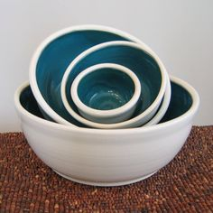 The peacock blue inside these handmade ceramic bowls is stunning! i want to accent some room with this color.