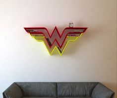 Bookshelves Shaped Like Superhero Logos by Artist Burak Dogan