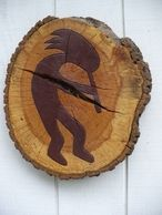Kokopeli Log Art, A pair, both hand painted and stained. The natural crack gives it a rustic look.