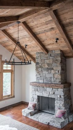 A Rustic And Cozy Reclaimed Cabin Can You Catch All Of The Reclaimed Material We Provided In This One Photo Alone Flooring Trim Mantel Ceiling Beams And Paneling Neutral Rugs And Patterned Pillows Are The Perfect Accents For This Space Cabin Fireplace, Rustic Fireplaces, Farmhouse Fireplace, Fireplace Design, Stacked Stone Fireplaces, Fireplace Stone, Rustic Home Design, Wood Ceilings, Wood Beams