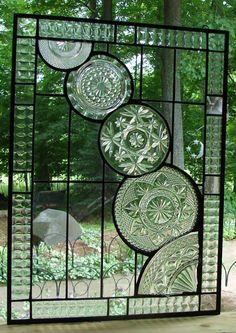 Beautiful window panel featuring vintage glassware