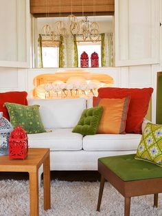 I love the idea of neutrals and natural materials as the majority of a room, and then adding surprises of bright, juicy colors and fabrics. So my taste. And that awesometastic midmod chair doesn't suck. At all.