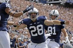 PENN STATE – FOOTBALL 2013 – Penn State running back Zach Zwinak (28) celebrates with teammates Brandon Felder (85), and Adam Breneman (81) after scoring on a two-yard run during the first quarter of an NCAA college football game against Eastern Michigan in State College, Pa., Saturday, Sept. 7, 2013. (AP Photo/Gene J. Puskar)