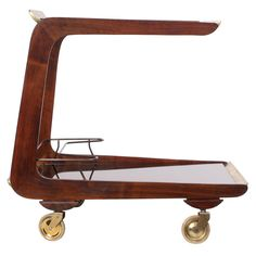 Cantilever Serving Cart by Carl Aubock | From a unique collection of antique and modern bar carts at https://www.1stdibs.com/furniture/tables/bar-carts/