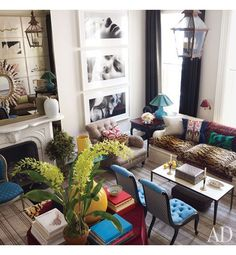 Love the large black & white prints and layout on the wall.{Architectural Digest}