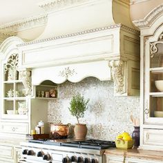 French country kitchen. pretty paint treatment and trim detail.  back splash is pretty