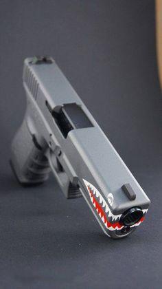 Thinking I need to paint my Glock 19 like this