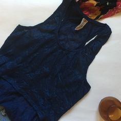 SUNDAY SALEFree People Crop Hi-Lo Tank Blue crinkle fabric with blue sparkles throughout from Free People. In great condition, perfect for over a bandeau. This top is size medium but fits more like a small because of the length: 20.5in Free People Tops Tank Tops