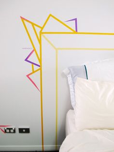 What better way to add impact on the cheap than to DIY a headboard made from washi tape!