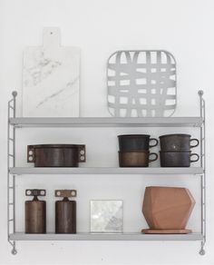 a great way of displaying interesting chopping boards and other kitchenwares