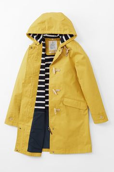 Seasalt mid-thigh length ladies' windproof and breathable waterproof coat with zip, toggle and rope fastenings, pockets, adjustable hood and cotton lining. Raincoat Outfit, Yellow Raincoat, Raincoats For Women, Jackets For Women, Outdoor Coats, Waterproof Coat, Seafolly, Rain Jacket, Outfit
