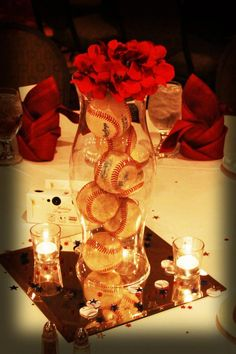 Our centerpieces (baseballs in a vase with flower on top)