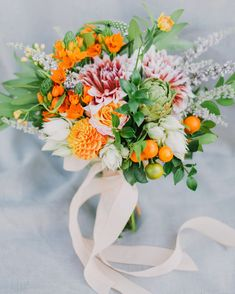 You can't go wrong with a classic white ribbon wrap, which helps the brightest-possible shades (like this Hello Gem bouquet's orange kumquats and mums) stand out. Summer Wedding Bouquets, Bride Bouquets, Flower Bouquet Wedding, Wedding Colors, Trailing Bouquet, Ribbon Bouquet, Bouquet Wrap, Beautiful Bouquet Of Flowers, Bright Flowers