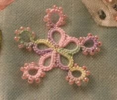 Tatted, beaded snowflake made to embellish a crazy quilt.
