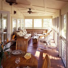 I love dining tables on porches! And enclosed porches... so beautiful!!