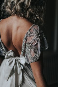 beaded wedding dress details - photo by Whitney Nichols Photography http://ruffledblog.com/glamorous-old-world-wedding-inspiration