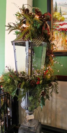 lamp post christmas decor for the table on the front porch Christmas Urns, Christmas Planters, Christmas Arrangements, Christmas Lantern Decor, Country Christmas, Outdoor Christmas, Christmas Lamp Post, Winter Christmas, Christmas Holidays