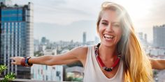 Beautiful Blonde Woman Laughing on a Balcony/Let your freak flag fly:11 struggles of being a highly sexual woman...