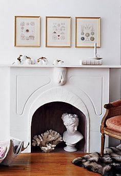 Add some eye-catching objects to your fireplace in the off-season.  #onekingslane and #designisneverdone