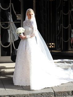 Blushing bride: Nicky Hilton, 31, donned a $77,000 couture Valentino gown featuring a high-neck and a long train on Friday when she wed billionaire banking heir James Rothschild, 31, at Kensington Palace