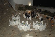 Wedding party at Outdoor Amphitheater with live band, at Mykonos Grand Hotel & Resort Mykonos Luxury Hotels, Myconos, Mykonos Town, Mykonos Island, Outdoor Stone, Live Band, Outdoor Venues, Luxury Holidays, Turquoise Water