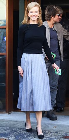 Nicole Kidman made a ladylike appearance for her visit to the Clayton Children's Hospital in Melbourne in Michael Kors separates—a black sweater and ice gray plaid glen skirt—with classic black pumps.